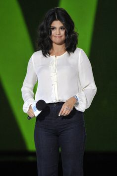 """Selena Gomez on stage co-hosting """"We Day Illinois"""" at the Allstate Arena in Rosemont, Illinois. April 30, 2015."""