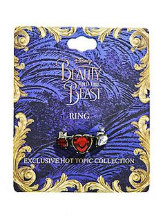 """<div>Replica ring from the live-action Disney movie <i>Beauty And The Beast</i>! What's it a replica of? Guess you'll have to see the movie when it releases to find out!</div><div><br></div><div>Hot Topic exclusive!</div><div><ul><li style=""""list-style-position: inside !important; list-style-type: disc !important"""">Metal</li><li style=""""list-style-position: inside !important; list-style-type: disc !important"""">Size 7</li><li style=""""list-style-position: inside !important; list-style-type: disc…"""