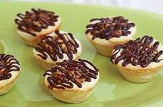 Pecan Tassies recipe  This recipe is awesome, and works great subbing the flour for almond flour.  I didn't put the chocolate topping when I made them.