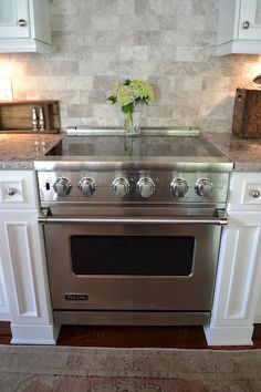 Great cabinetry details accenting the stove area. via Three Pixie Lane