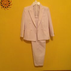 Tuxedo suit boy size 7 Stunning tuxedo suit boy size 7, made in Canada, never worn, some tags still attached. Pants length 28 1/2,waist 11 and stretchable on a back Pants