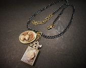 Ivory Rabbit with Rose Book Charms Black and Gold Chain Necklace