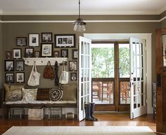 """Erin and Ben Napier   Home Town on HGTV The entry paint is Java by Eddie Bauer. Sometimes it's grey, sometimes it's green or brown. @scotsman.co made the screen doors to the porch and in the spring and fall, I love to hear that creeeeeeak SMACK of coming and going."""""""