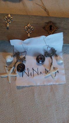Legno, metallo e conchiglie By NiNa