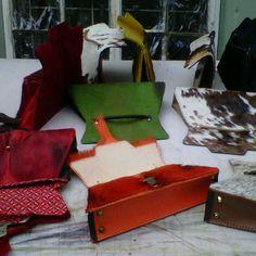 Envelop bags with coloured springbok, nguni and shweshwe lining.