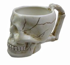 Start your morning routine off right with this super cool skull shaped ceramic coffee mug. Standing 4 inches tall, 3 inches deep and 6 inches wide (including the bone shaped handle.) by Hercio Dias Best Coffee Mugs, Coffee Cups, Tea Cups, Pineapple Kale Smoothie, Gourmet Cooking, Clay Design, Ceramic Cups, Halloween Gifts, Mug Cup