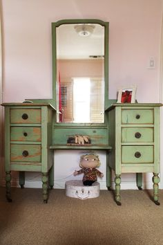 A green vanity (which belonged to the mother) in a pink girl's bedroom.