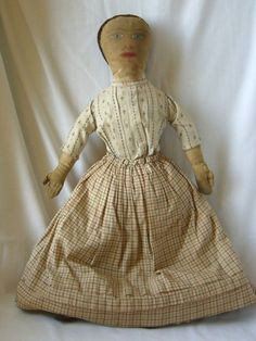 Early Folk Art Cloth Doll with Hand Painted Face - circa late 1800's. Great fabric uses on clothing.