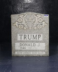 The Trump Tombstone with Evidence Stickers from the NYPD