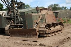 Bulldozer Vehicle   Preserved armoured D7 with millitary crane based on a dozer behind