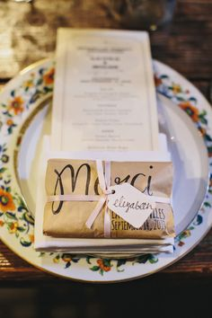 """Merci"" wrapped favors, photo by Clean Plate Pictures http://ruffledblog.com/romantic-brooklyn-winery-wedding #favors #weddingideas #papergoods"