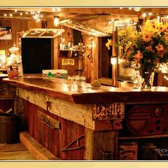 wood bench is cool and low lux fairy lights are a must for the liquor surrounds too