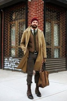 Men's Burgundy Beanie, White Longsleeve Shirt, Dark Green Print Tie, Brown Wool Waistcoat, Black Leather Belt, Camel Overcoat, Brown Wool Gloves, Charcoal Jeans, Brown Canvas Tote Bag, and Dark Brown Leather Boots