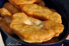 Langosi (fried dough filled with feta) Romanian Desserts, Romanian Recipes, Romania Food, Delicious Desserts, Dessert Recipes, Good Food, Yummy Food, Hungarian Recipes, Hungarian Food
