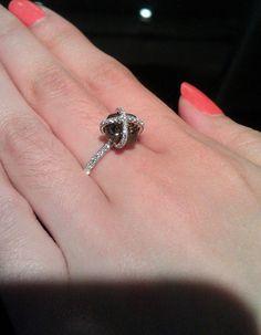 black rough diamond with white pave diamonds engagement ring. Gorgeous. Wish the diamond wasn't so dark