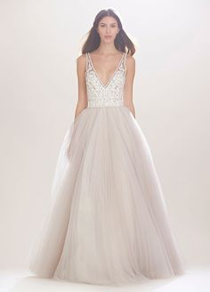 BEST DRESSES FROM FALL 2016 BRIDAL FASHION WEEK ==  A deep-V crystal neckline and full skirt make this Carolina Herrera dress perfect for the princess bride.