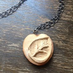 Items similar to Carved Avocado Pit Necklace - Leaf on Etsy Seed Art, Dremel Carving, Peach Pit, Avocado Seed, Unusual Things, Whittling, Nature Crafts, Wood Crafts, Jewelry Art