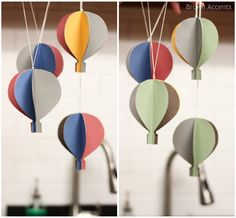 Hot air balloon mobile--could use the same concept for other shapes punched from cardstock.