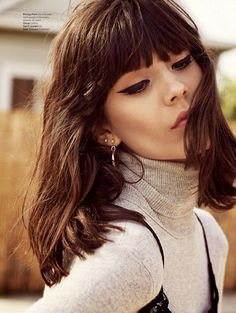 Blunt tapered fringe with long brown bob. Fringe cut just below brow length, tapered to cheekbone length; boxy to oval face shape, high forehead