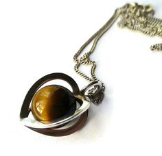 Hey, I found this really awesome Etsy listing at https://www.etsy.com/listing/470307304/elis-kauppi-caged-tigers-eye-pendant