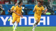 Tim Cahill of Australia (R) celebrates scoring his teams first goal with teammate Mark Milligan