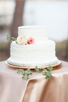 Textured wedding cake with floral accent. #cake #weddingcake #weddingchicks Cake By: The Party House & Bakery ---> http://www.weddingchicks.com/2014/04/25/table-for-two-romantic-engagement/