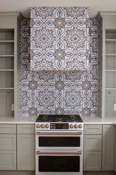 One of the first things I designed for this kitchen was a blue and white patterned tile hood. And I couldn't be happier with it! #patternedtile