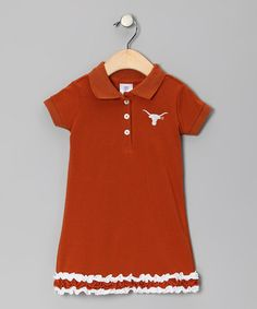 Take a look at this Burnt Orange & White Texas Ruffle Polo Dress:::