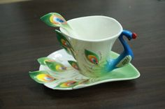 Peacock cup and saucer