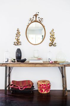 "This Blogger's Brand-New L.A. Home Is Impossibly Dreamy #refinery29  http://www.refinery29.com/2015/09/94026/sf-girl-by-bay-blog-home-tour#slide-11  ""I wasn't sure about these gold fixtures, because they're kind of crazy and I didn't want it to be too shabby chic,"" Smith said. ""The mirror was from Urban Outfitters. They were having a fixture sale from their old displays, so I got it for $20. The sconces I've had forever and they were $5 at the flea market. This side table is my shrine to…"