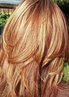red or auburn hair with subtle, natural blonde highlights. So want this maybe for summer? Amber can we do this?