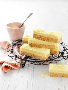 This delectable lemon coconut slice is the perfect blend of zesty and sweet. This no-bake slice makes for a delicious afternoon or morning tea and can be even given as a edible gift. Lemon Recipes, Raw Food Recipes, Sweet Recipes, Baking Recipes, Dessert Recipes, Dessert Bars, Lemon Coconut Slice, No Bake Lemon Slice, No Bake Slices