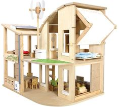 Plan Toys Green Dollhouse will engage pre-schoolers in imaginative play while teaching kids about the art of green living. Includes furniture to fully furnish five rooms. Features solar panels, rainbarrel, recycling bins, and more! Wooden Dollhouse, Wooden Dolls, Diy Dollhouse, Dollhouse Design, Dollhouse Furniture Sets, Miniature Furniture, Doll House Plans, Plan Toys, Recycling Bins