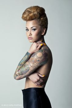 Rockabilly hair and awesome tats, love her style