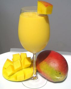 How To Make Mango Lassi - Indian Drink. If using frozen mango don't add ice. Finish with a sprig of mint.