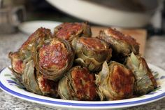 Sausage stuffed artichokes. I really want to give these veggies a try in my own kitchen!