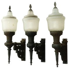 Set of Three Cast Iron Exterior Sconces, Novalux   From a unique collection of antique and modern wall lights and sconces at https://www.1stdibs.com/furniture/lighting/sconces-wall-lights/