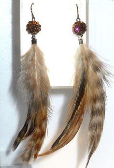 http://www.bonanza.com/listings/Metal-Sparkle-4-Feather-Dangle-Earrings/90225359    http://www.bonanza.com/booths/jewelrywiz