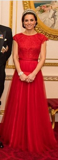 Catherine, Duchess of Cambridge in a gorgeous red Jenny Packham gown worn previously to a state dinner with the president of China. Jenny Packham design features subtle embellishments around the bodice before it nips in her waist and elegantly falls into a floor-sweeping A-line skirt.