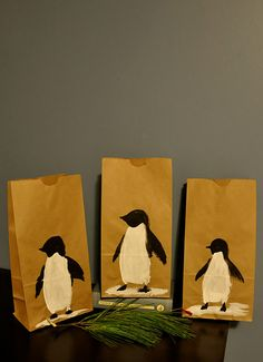 Sometimes a DIY gift bag is just as thoughtful as the gift itself. These are such cute DIY holiday decorations on these DIY gift bags. #christmas #penguin