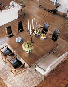 """The """"X"""" in the boards of the table are the leaves that can be removed/added to adjust seating. Ingenious!"""