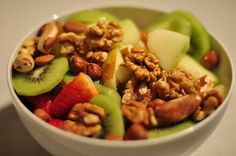Sliced kiwi and strawberries plus sliced green apples; garnished with  mixed nuts and walnuts. Click for more ideas!