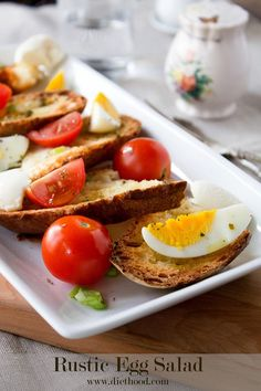 Rustic Egg Salad made with crunchy, toasted bread, hard boiled eggs, tomatoes, green onions, soft cheese, and a drizzle of olive oil - Simple, yet incredibly delicious and comforting.