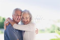 Older couple hugging outdoors--This is so  patronizing.  Should they hug inside?