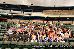 Guests at a wedding ceremony held at Kino Veterans Memorial Stadium Baseball Stadium and Sports Complex in Tucson AZ Arizona pose or a group portrait in the bleachers.  Photo by Michael Chansley Photography wedding photographer ideas decorations venue baseball theme themed Bride ideas