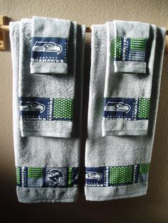 Seattle Seahawks Bathroom Towels. I could make these but I would use dark blue towels or green ones. Not the gray, they will tend to look dingy.