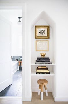 What a pretty white + gold vignette! These paint-dipped stools are the best.