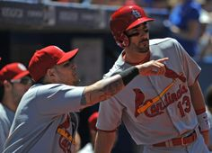 Molina points out something to Carpenter, 6-7-2014