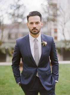 navy suit, grey tie | Photography: Greg Finck