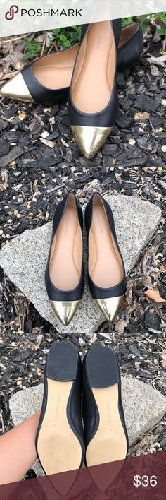 Banana Republic sz 9 Black and Gold Flats Really nice barely worn black and gold ballet flats pumps in black leather with gold pointed toe. Size 9. Genuine leather and manmade materials. Non-smoking.  Bundle with another item in my closet to save 15%! Banana Republic Shoes Flats & Loafers
